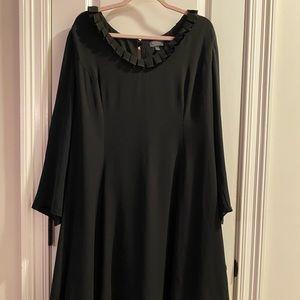 Limited black swing dress. Ruffle neckline.